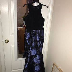 Black special occasion dress with blue flowers